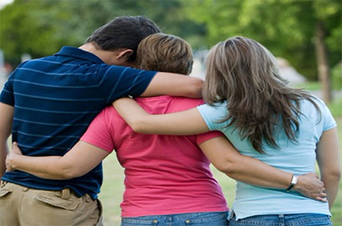 family hugging after therapy